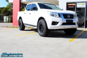 Right front side view of a White Nissan NP300 Navara Dual Cab before fitment of a range of Superior and various other brands suspension components