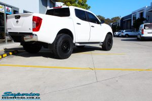 Rear right view of a White Nissan NP300 Navara Dual Cab before fitment of a range of Superior and various other brands suspension components