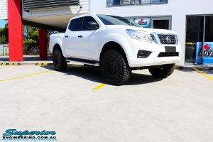 Right front side view of a White Nissan NP300 Navara Dual Cab after fitment of a range of Superior and various other brands suspension components