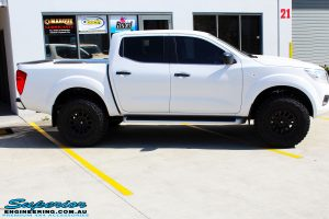 Right side view of a White Nissan NP300 Navara Dual Cab after fitment of a range of Superior and various other brands suspension components