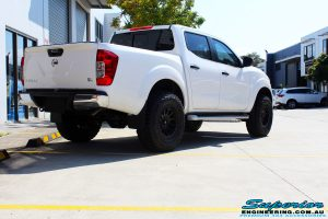 Rear right view of a White Nissan NP300 Navara Dual Cab after fitment of a range of Superior and various other brands suspension components
