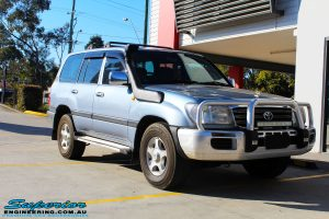 """Right front side view of a Blue Toyota 100 Series Landcruiser before fitment of a 2"""" Inch Lift Kit"""