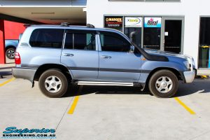 """Right side view of a Blue Toyota 100 Series Landcruiser before fitment of a 2"""" Inch Lift Kit"""