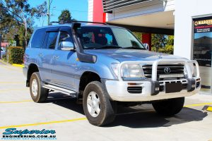 """Right front side view of a Blue Toyota 100 Series Landcruiser after fitment of a 2"""" Inch Lift Kit"""
