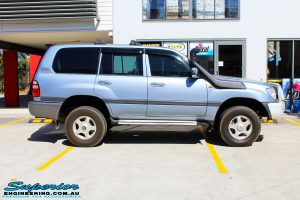 "Right side view of a Blue Toyota 100 Series Landcruiser after fitment of a 2"" Inch Lift Kit"
