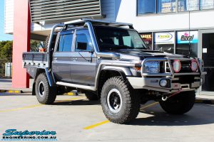 Right front side view of a Grey Toyota 79 Series Landcruiser Dual Cab before fitment of a range of Suspension Components and 4x4 Accessories