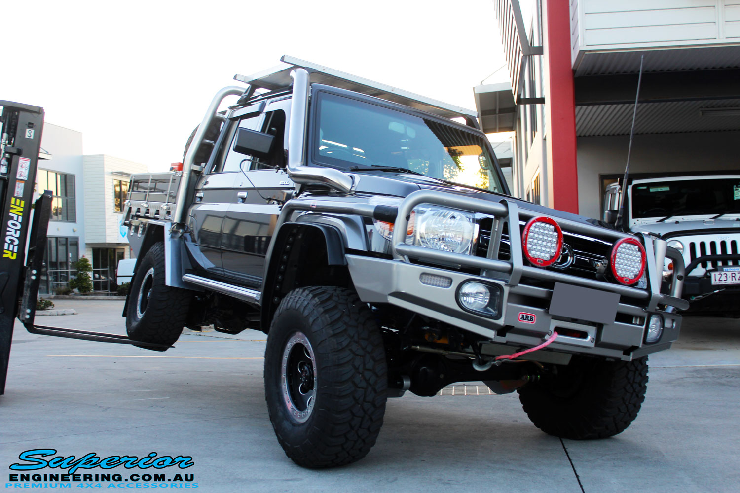 """Front right shot of the flex after fitment of a 3"""" Inch Remote Reservoir Lift + Superflex Radius Arms"""