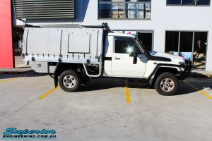 Right side view of a White Toyota 79 Series Landcruiser before fitment of a MDT Tru Tracker Complete Rear Track Correction System