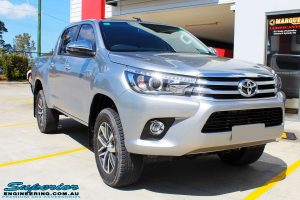 Right front side view of a Silver Toyota Revo Hilux Dual Cab before fitment of a range of Superior and various other brands suspension components