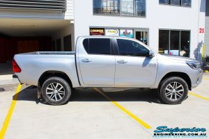 Right side view of a Silver Toyota Revo Hilux Dual Cab before fitment of a range of Superior and various other brands suspension components