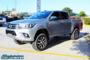 Front left view of a Silver Toyota Revo Hilux Dual Cab after fitment of a range of Superior and various other brands suspension components