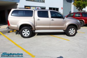 Right side view of a Gold Toyota Vigo Hilux Dual Cab before fitment of EFS Coil Springs, Ironman 4x4 Deluxe Commercial Black Bullbar & VRS Winch
