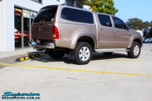 Rear right view of a Gold Toyota Vigo Hilux Dual Cab before fitment of EFS Coil Springs, Ironman 4x4 Deluxe Commercial Black Bullbar & VRS Winch