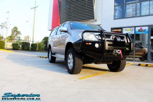 Right front side view of a Gold Toyota Vigo Hilux Dual Cab after fitment of EFS Coil Springs, Ironman 4x4 Deluxe Commercial Black Bullbar & VRS Winch