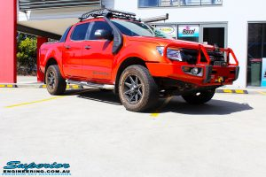 "Right front side view of a Orange Ford PX Ranger before fitment of a Bilstein 2"" Inch Lift Kit"