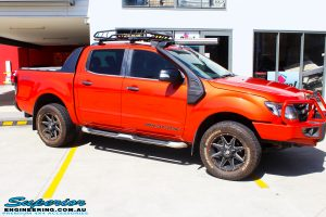 """Right side view of a Orange Ford PX Ranger before fitment of a 2"""" Inch Lift Kit"""