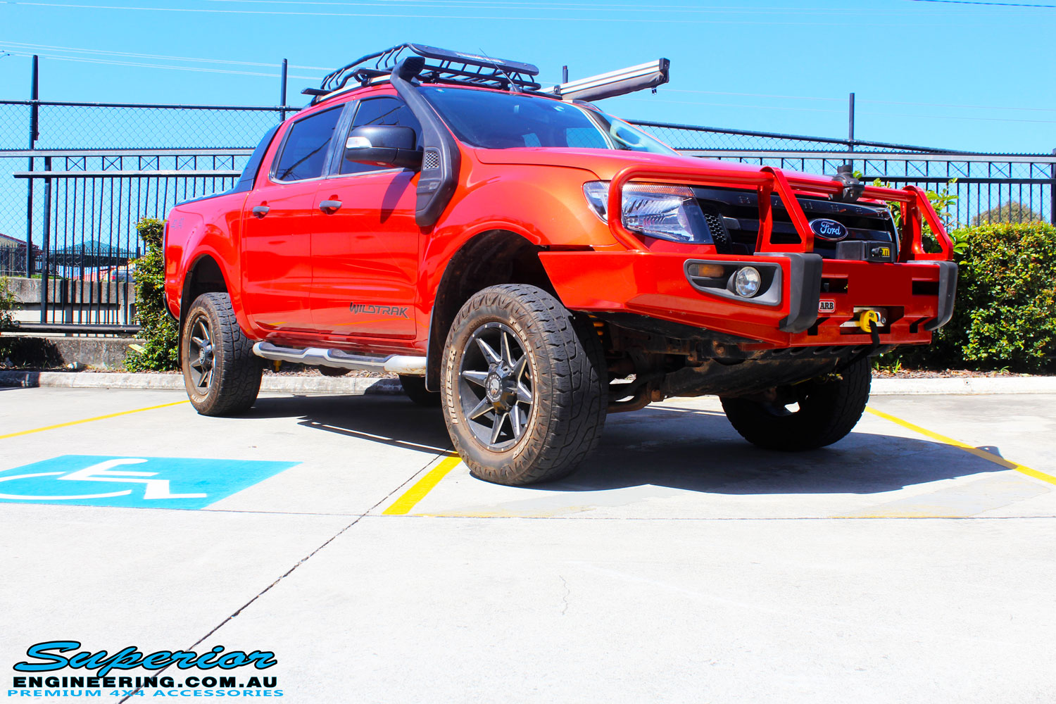 """Right front side view of a Orange Ford PX Ranger after fitment of a Bilstein 2"""" Inch Lift Kit"""