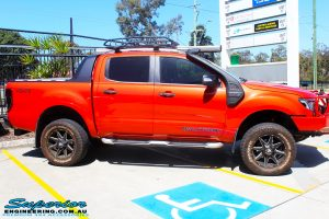 """Right side view of a Orange Ford PX Ranger after fitment of a 2"""" Inch Lift Kit"""