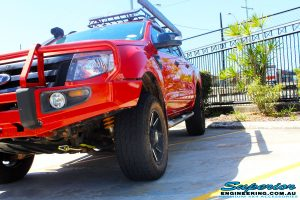 "Front left front on view of a Orange Ford PX Ranger after fitment of a 2"" Inch Lift Kit"