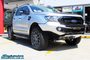 Right front side view of a Silver Ford PXIII Ranger Dual Cab after fitment with a Rhino 4x4 Evolution 3D Winch Bar