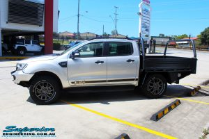 Left side front shot of a Silver Ford PXIII Ranger Dual Cab after fitment with a Rhino 4x4 Evolution 3D Winch Bar