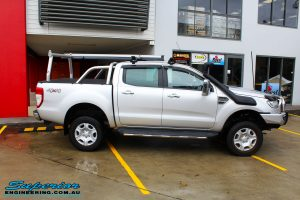Right side shot of a Ford PXII Ranger in Silver On The Hoist @ Superior Engineering Deception Bay Showroom