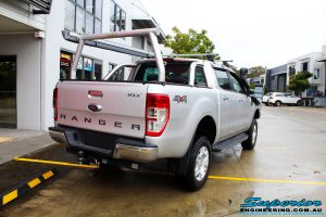 Rear right view of a Ford PXII Ranger in Silver On The Hoist @ Superior Engineering Deception Bay Showroom