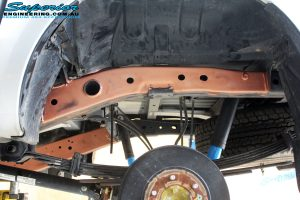 Rear left view of the chassis brace being prepped for fitment