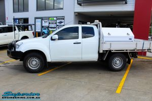 """Left side view of a White Isuzu D-Max Space Cab before fitment of a Superior Nitro Gas 2"""" Inch Lift Kit"""