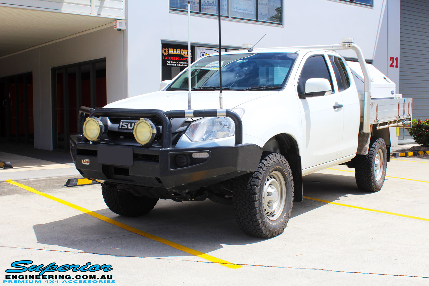 """Left front side view of a Silver Isuzu D-Max Dual Cab after fitment of a Superior Nitro Gas 2"""" Inch Lift Kit"""