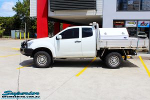 """Left side view of a Silver Isuzu D-Max Dual Cab after fitment of a Superior Nitro Gas 2"""" Inch Lift Kit"""