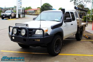 Left front side view of a White Mazda BT-50 Freestyle Cab before fitment of a Tough Dog 45mm Lift Kit