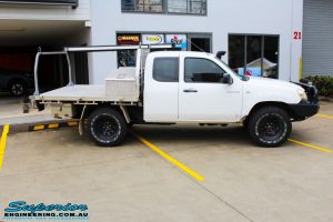 Right side view of a White Mazda BT-50 Freestyle Cab before fitment of a Tough Dog 45mm Lift Kit