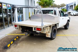 Rear right view of a White Mazda BT-50 Freestyle Cab before fitment of a Tough Dog 45mm Lift Kit