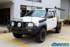 Left front side view of a White Mazda BT-50 Freestyle Cab after fitment of a Tough Dog 45mm Lift Kit