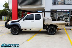 Left side view of a White Mazda BT-50 Freestyle Cab after fitment of a Tough Dog 45mm Lift Kit
