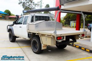 Rear left view of a White Mazda BT-50 Freestyle Cab after fitment of a Tough Dog 45mm Lift Kit