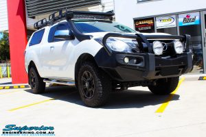 """Right front side view of a Mazda BT50 Freestyle Cab in White before fitment of a Superior Nitro Gas 2"""" Inch Lift Kit"""