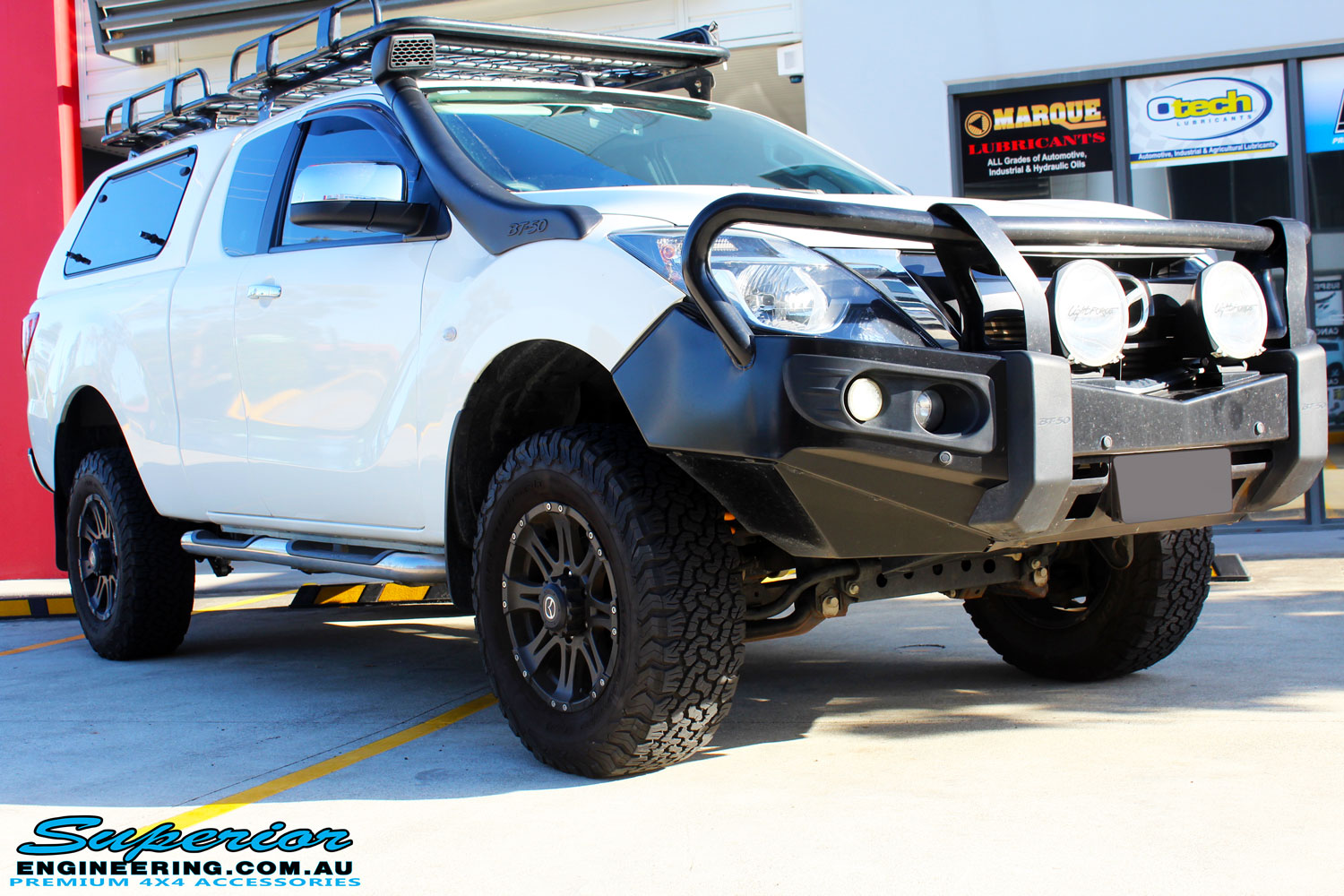 "Right front side view of a Mazda BT50 Freestyle Cab in White before fitment of a Superior Nitro Gas 2"" Inch Lift Kit"