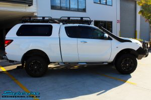 """Right side view of a Mazda BT50 Freestyle Cab in White before fitment of a Superior Nitro Gas 2"""" Inch Lift Kit"""