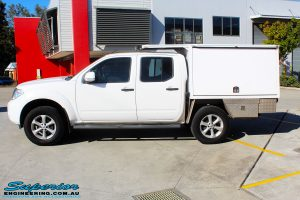 Left side view of a Nissan D40 Navara in White On The Hoist @ Superior being fitted with a Chassis Brace/Repair Plate