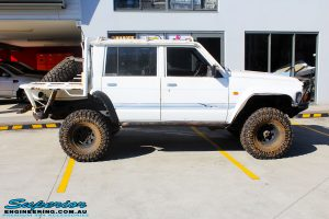 Right side view of a White Nissan GQ Patrol Dual Cab before fitment of a range of Superior and various other brands suspension components