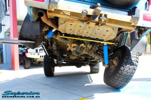 Rear mid underbody shot of this Nissan GQ Patrol whilst being flexed on its rear left wheel