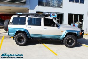 "Right side view of a Blue Nissan GQ Patrol after fitment of a Superior Remote Reservoir Hybrid Superflex 3"" Inch Lift Kit"