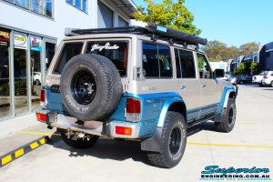 """Rear right side view of a Blue Nissan GQ Patrol after fitment of a Superior Remote Reservoir Hybrid Superflex 3"""" Inch Lift Kit"""