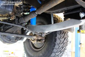 """Front right underbody shot looking at the fitted Superior Hybrid Superflex Radius Arm with Drop Box, Superior Adjustable Remote Reservoir 3"""" Shock & Coil Spring"""