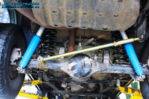 Rear mid underbody view looking at the fitted Superior Adjustable Panhard Rod, Remote Reservoir Shocks & Coil Springs