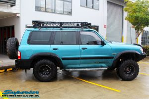 """Right side view of a Blue Nissan GU Patrol before fitment of a Superior Nitro Gas Hyperflex 3"""" Inch Lift Kit with Superior Control Arms Long Arm Kit"""