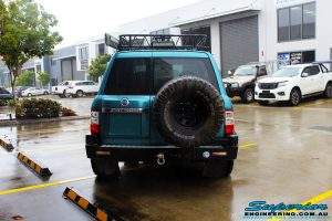 "Rear view of a Blue Nissan GU Patrol before fitment of a Superior Nitro Gas Hyperflex 3"" Inch Lift Kit with Superior Control Arms Long Arm Kit"