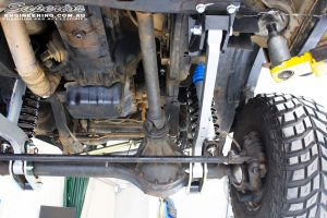 Mid right underbody shot looking forward of the fitted Superior Hyperflex Radius Arms, Nitro Gas Shocks and Coil Springs